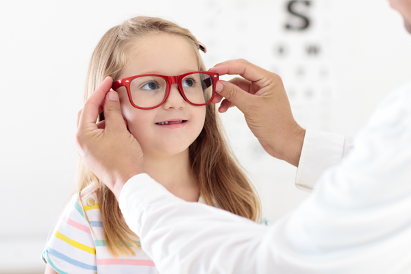 child getting eye exam